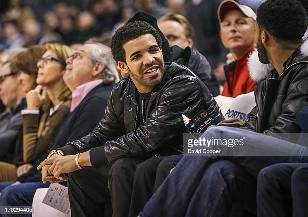 Canadian Rapper Drake sits court side as the Toronto Raptors defeat the Phoenix Suns 10197 at the Air Canada Centre November 30 2012 DAVID...