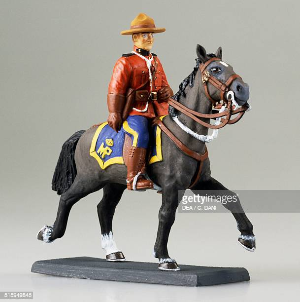 Canadian red mounted police toy soldier on horseback Canada 20th century