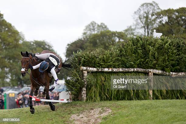 Canadian rider Rebecca Howard falls from her horse 'Riddle Master' at the Mirage Pond jump of the Cross County discipline on the penultimate day of...