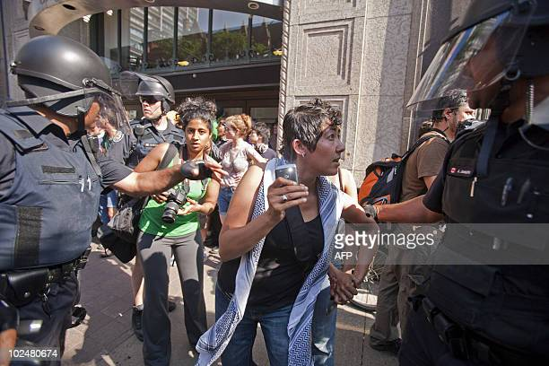 Canadian riot police face protestors near the site of the G20 summit in Toronto on June 26 2010 Some 2000 noisy demonstrators came face to face with...