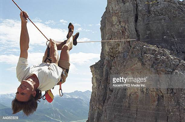 canadian rockies, man upside down on tyrolean traverse - bridging the gap stock pictures, royalty-free photos & images