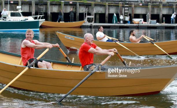 Canadian rowers Brent and Todd Dempsey strain against their oars as they approach the finish line during the Senior's Division of the International...