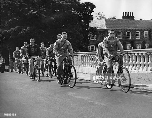 Canadian rowers from Vancouver Rowing Club cycling over Henley Bridge on their way to a training session the day before the start of Henley Royal...
