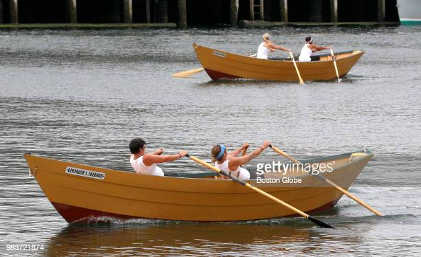 Canadian rowers Kath Moore and Gail Atkinson near the finish line and victory during the Women's Division of the International Dory Races against US...