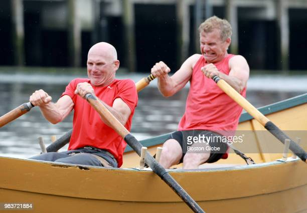 Canadian rowers Todd left and Brent Dempsey strain against their oars at the start of the Senior's Division of the International Dory Races against...