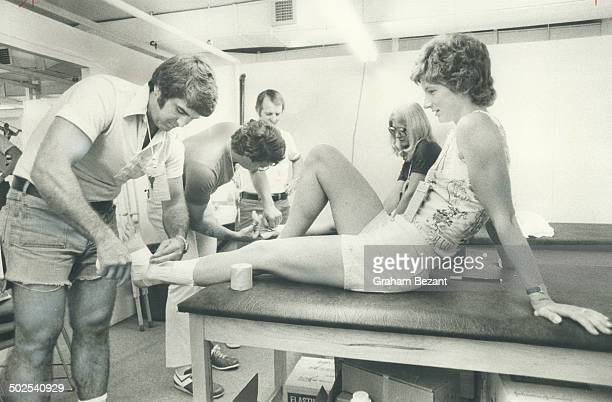 Canadian runner Joyce Yakubowich gets ankle taped during Olymp ic training in Montreal