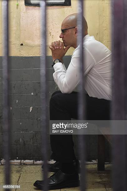 Canadian school administrator Neil Bantleman sits in a court detention cell in Jakarta shortly before his court appearance to face a verdict on April...