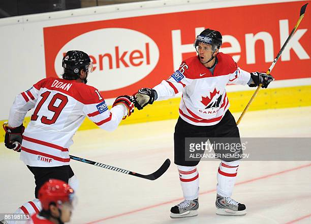 Canadian Shane Doan and Martin St Louis celebrate after their teammates' scoring against team Belarus during their preliminary round group A game at...