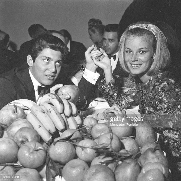Canadian singer and composer Paul Anka and his wife Lebaneseborn British model Anne de Zogheb holding hands smiling during the 14th Sanremo Music...