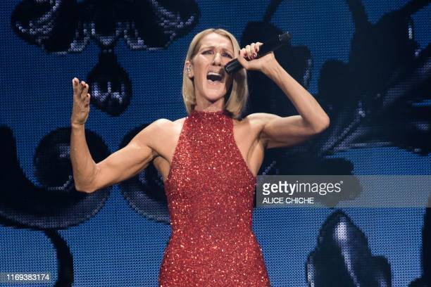 TOPSHOT Canadian singer Celine Dion performs on the opening night of her new world tour Courage at the Videotron Centre in Quebec City Quebec on...