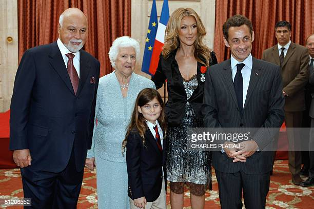 Canadian singer Celine Dion poses with her husband Rene Angelil , her child Rene-Charles, her mother Therese , and French President Nicolas Sarkozy ,...