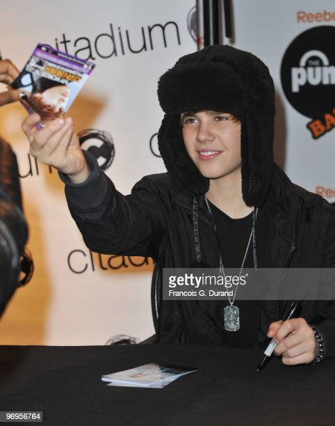 Canadian singer Justin Bieber signs autographs to promote his new album at Citadium store on February 22, 2010 in Paris, France.