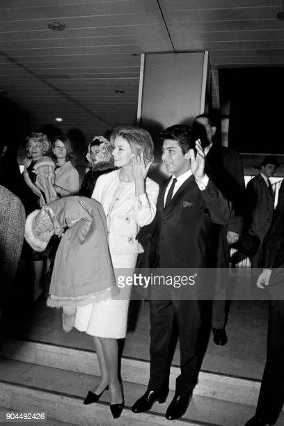Canadian singer Paul Anka and his wife Anne de Zogheb wave before their departure to Zurich at the Orly airport on February 16 1963 after celebrating...
