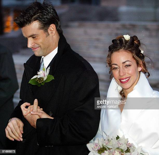 Canadian singer Roch Voisine and his bride Myriam StJean exit St Viateur Church after their wedding 21 December 2002 in Montreal The couple met this...