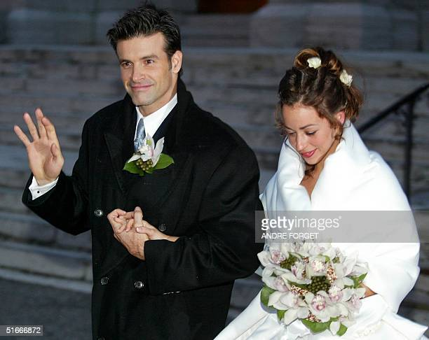 Canadian singer Roch Voisine waves to fans as he and his bride Myriam StJean exit St Viateur Church after their wedding 21 December 2002 in Montreal...