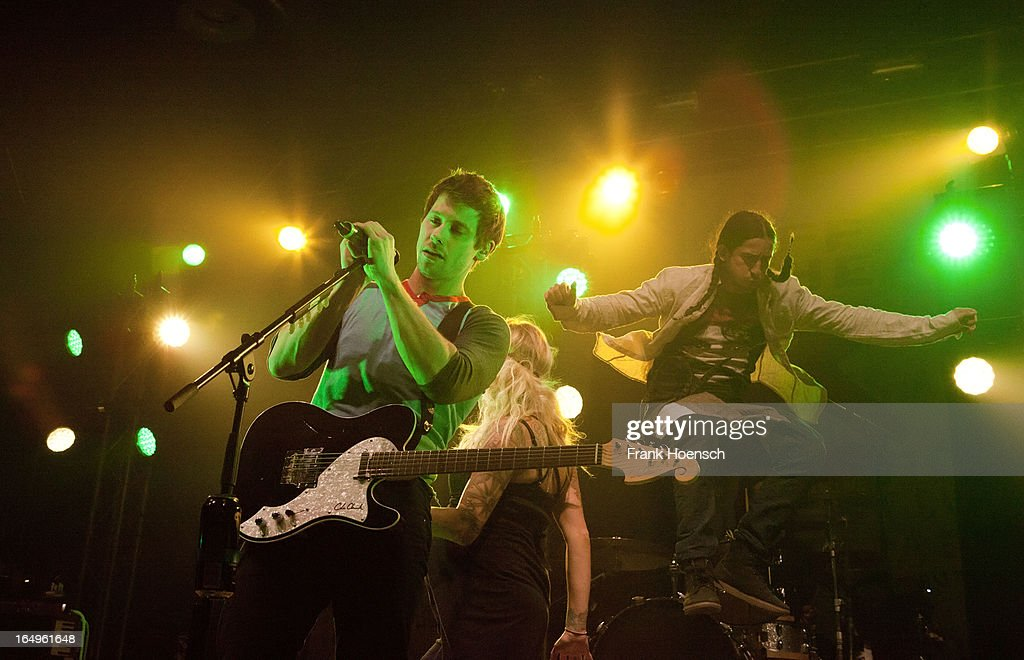 Canadian singer Sarah Blackwood and Gianni 'Luminati' Nicassioof (L-R) Walk Off The Earth performs live during a concert at the Huxleys on March 29, 2013 in Berlin, Germany.