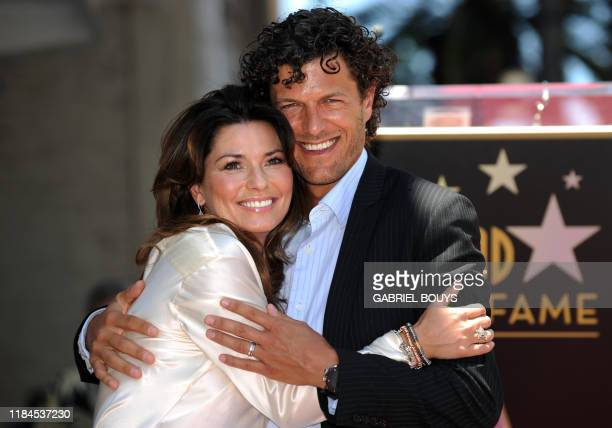 Canadian singer Shania Twain poses with her husband Frederic Nicolas Thiebaud after being honored by a Star on the Hollywood Walk of Fame in...