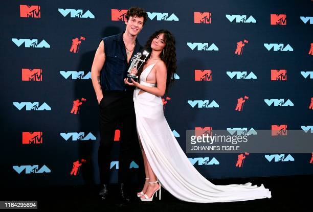 Canadian singer Shawn Mendes and USCuban singersongwriter Camila Cabello pose with an award in the press room during the 2019 MTV Video Music Awards...