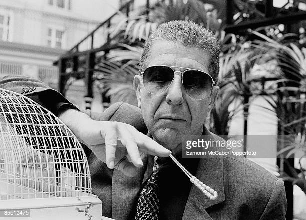 Photo of Leonard COHEN posed wearing sunglasses