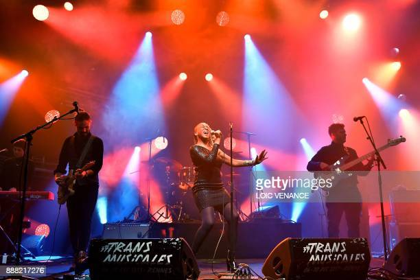 Canadian singer Tanika Charles performs on stage during the 39th edition of the Trans Musicales music festival in SaintJacquesdelaLande outside...