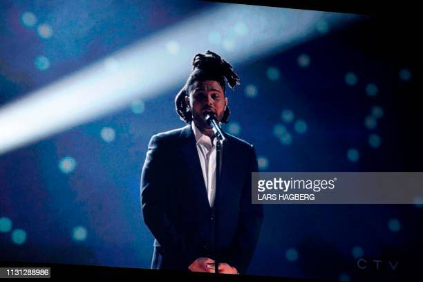 Canadian singer The Weeknd performs via video screen during the Juno Music Awards at Budweiser Gardens in London Ontario Canada on March 17 2019