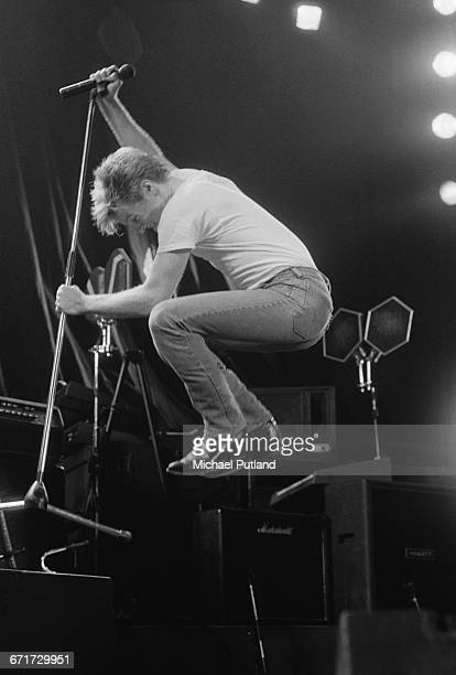 Canadian singersongwriter Bryan Adams performing on Tina Turner's Private Dancer Tour on one of four nights at Wembley Arena London 14th17th March...