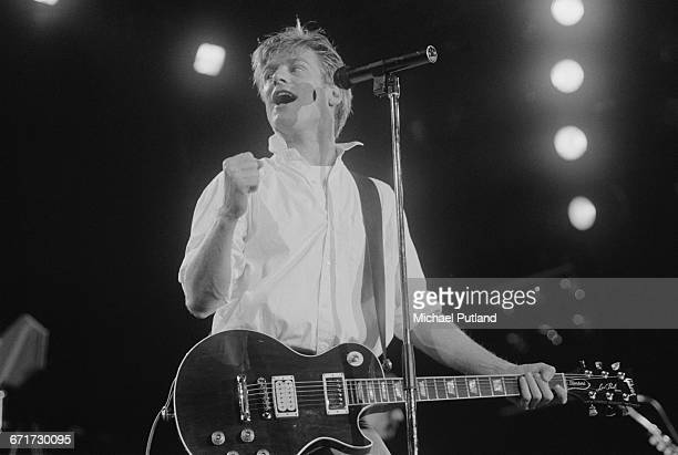 Canadian singer-songwriter Bryan Adams performing on Tina Turner's Private Dancer Tour, on one of four nights at Wembley Arena, London, 14th-17th...