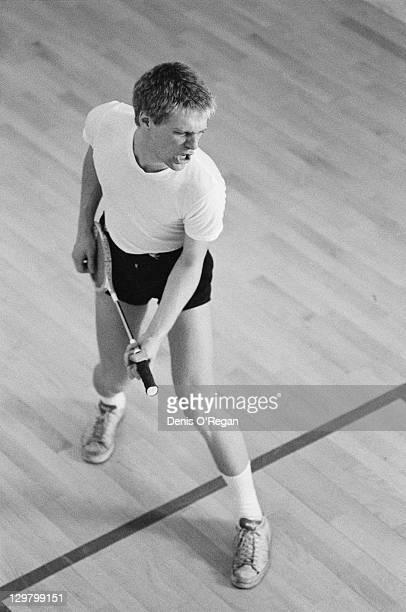 Canadian singersongwriter Bryan Adams strumming a squash racket at a video shoot in a gymnasium circa 1985