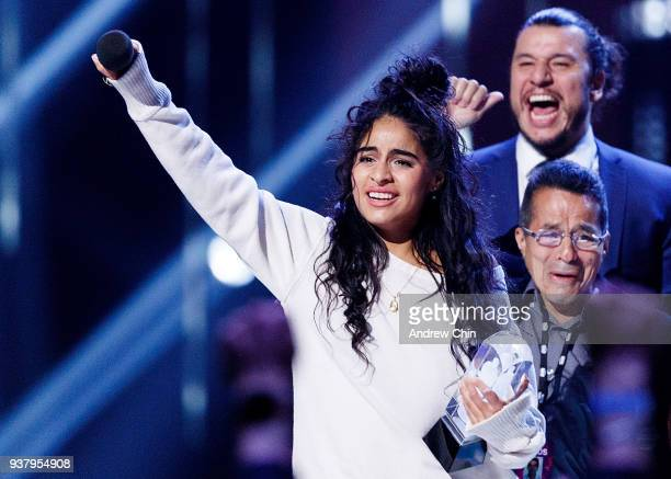 Canadian singersongwriter Jessie Reyez receives the award for 'Breakthrough Artist of the Year' during the 2018 JUNO Awards at Rogers Arena on March...