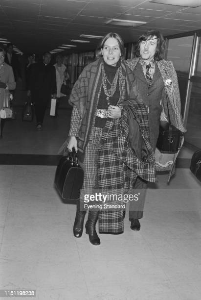 Canadian singer-songwriter Joni Mitchell with English singer-songwriter and musician Graham Nash at Heathrow Airport, London, UK, 30th December 1969.