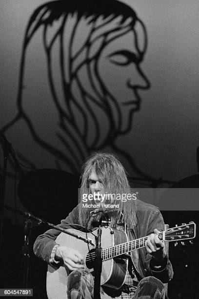 Canadian singersongwriter Neil Young performing at Hammersmith Odeon London 28th March 1976