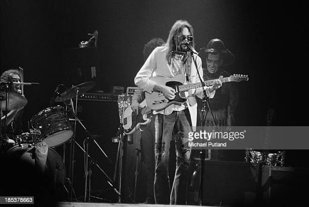 Canadian singersongwriter Neil Young performing with The Santa Monica Flyers at the Rainbow Theatre London 5th November 1973 Ralph Molina is on drums