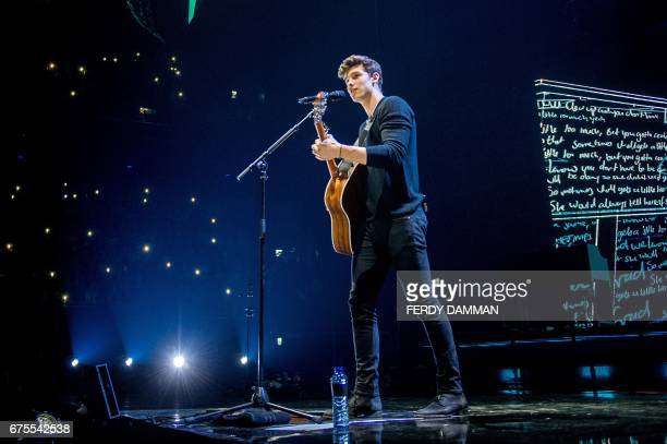 Canadian singersongwriter Shawn Mendes performs during his Illuminate Tour at the Ziggo Dome in Amsterdam on May 1 2017 / AFP PHOTO / ANP / Ferdy...