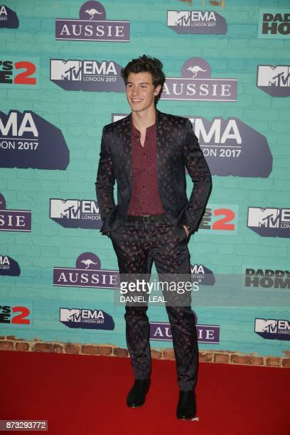 Canadian singersongwriter Shawn Mendes poses on the red carpet arriving to attend the 2017 MTV Europe Music Awards at Wembley Arena in London on...