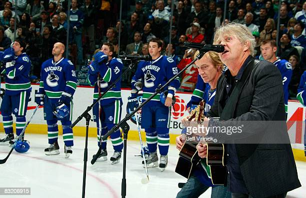 Canadian singersongwriter Tom Cochrane sings a tribute to late Vancouver Canuck defenseman Luc Bourdon at the start of the game between the Canucks...