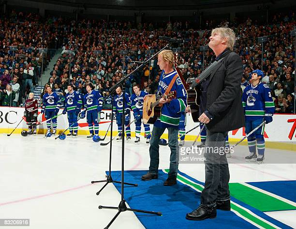 Canadian singer-songwriter Tom Cochrane sings a tribute to late Vancouver Canuck defenseman Luc Bourdon at the start of the game between the Canucks...