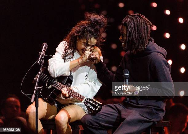 Canadian singersongwriters Jessie Reyez and Daniel Caesar perform on stage during the 2018 JUNO Awards at Rogers Arena on March 25 2018 in Vancouver...