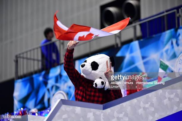 Canadian skater cheers for KirstenMooreTowers and MichaelMarinaro of Canada prior to competing in the Pair Free Skating on day three of the ISU...