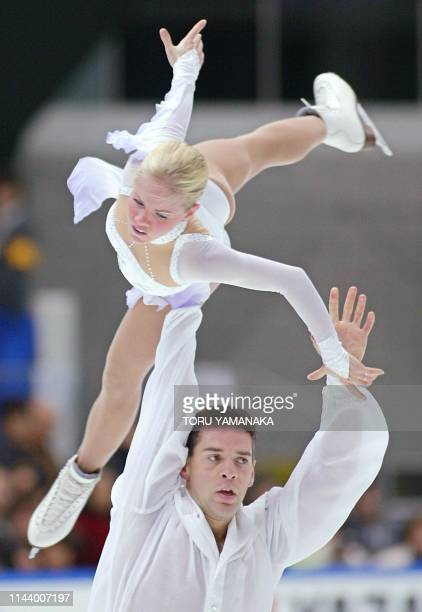 Canadian skater Patrice Archetto lifts his partner Anabelle Langlois during pairs press program in the NHK Trophy figure skating competition in...