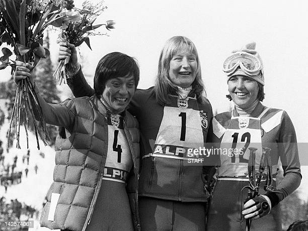 Canadian skier Kathy Kreiner West German Rosi Mittermaier and French Daniele Debernard smile after the women's giant slalom at the Winter Olympic...