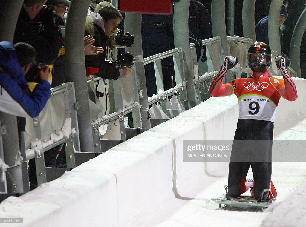 Canadian slider Jeff Pain celebrates after taking the silver medal in the men's skeleton event at the Turin 2006 Winter Olympics in Cesana Pariol, 17 February 2006.