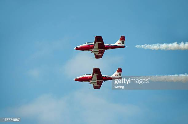 canadian snow birds in flight.. two planes - canadian snowbird stock pictures, royalty-free photos & images