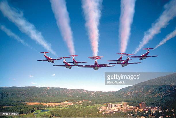 canadian snowbirds in formation - canadian snowbird stock pictures, royalty-free photos & images