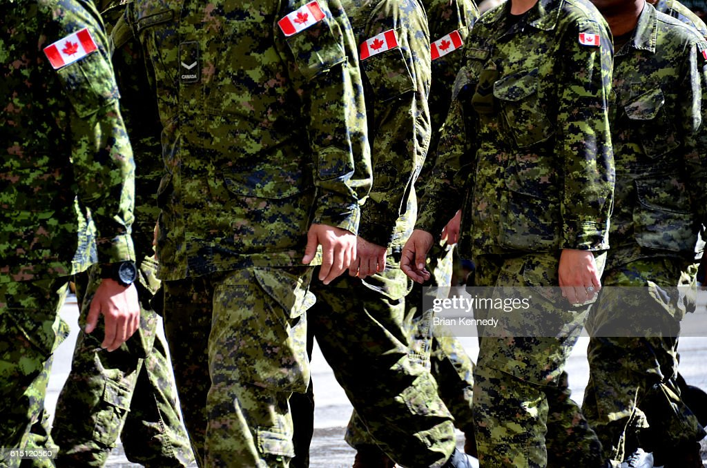 Canadian Soldeiers in Camo Marching : Stock Photo