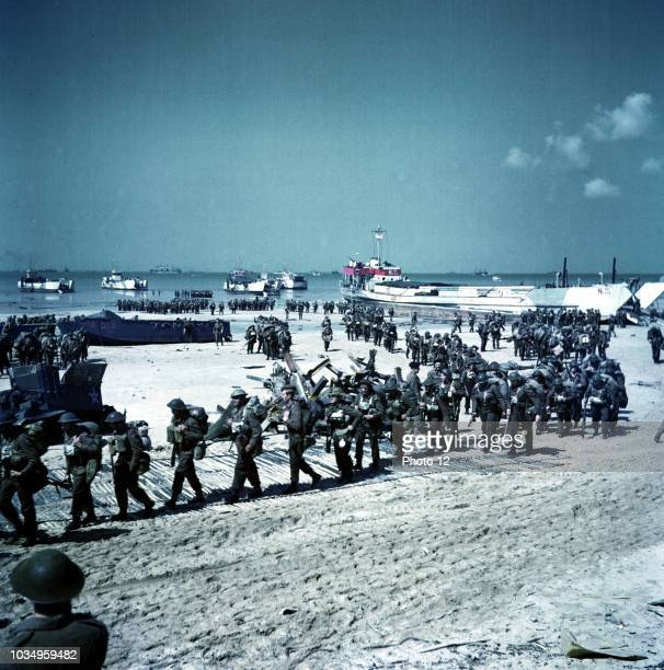 Canadian soldiers being deployed on Juno Beach Normandy This image was taken after the initial DDay landings Dated in 1944