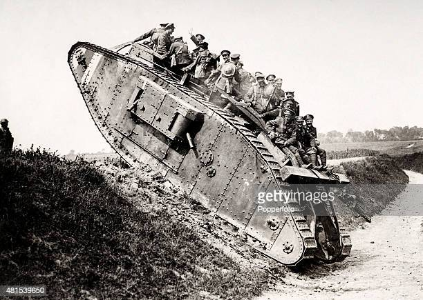 Canadian soldiers climbing the side of a sunken road in a tank during World War One circa 1915