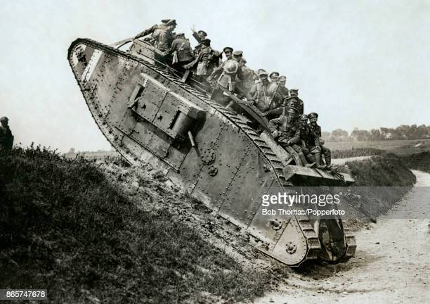Canadian soldiers climbing the side of a sunken road in their tank during World War One, circa 1916.