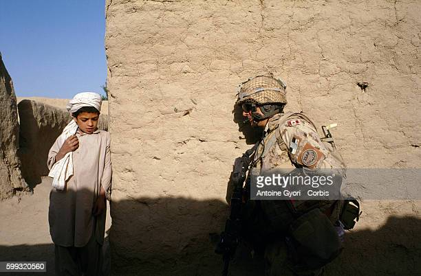 Canadian soldiers from the Operational Mentoring and Liaison Team patrol in the village of Sperwan Ghar The OMLT is made up of some 200 Canadian...