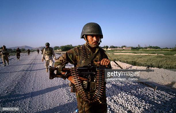 Canadian soldiers from the Operational Mentoring and Liaison Team patrol in the village of Sperwan Ghar with soldiers of the Afghan National Army The...