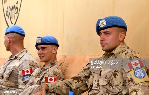 Canadian soldiers of the MINUSMA force sit at the contigents' camp in Gao on July 31, 2018. - Canadian troops have been arriving in Mali since the...